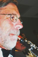 Photo of Harry Griswold playing the oboe, by anonymous